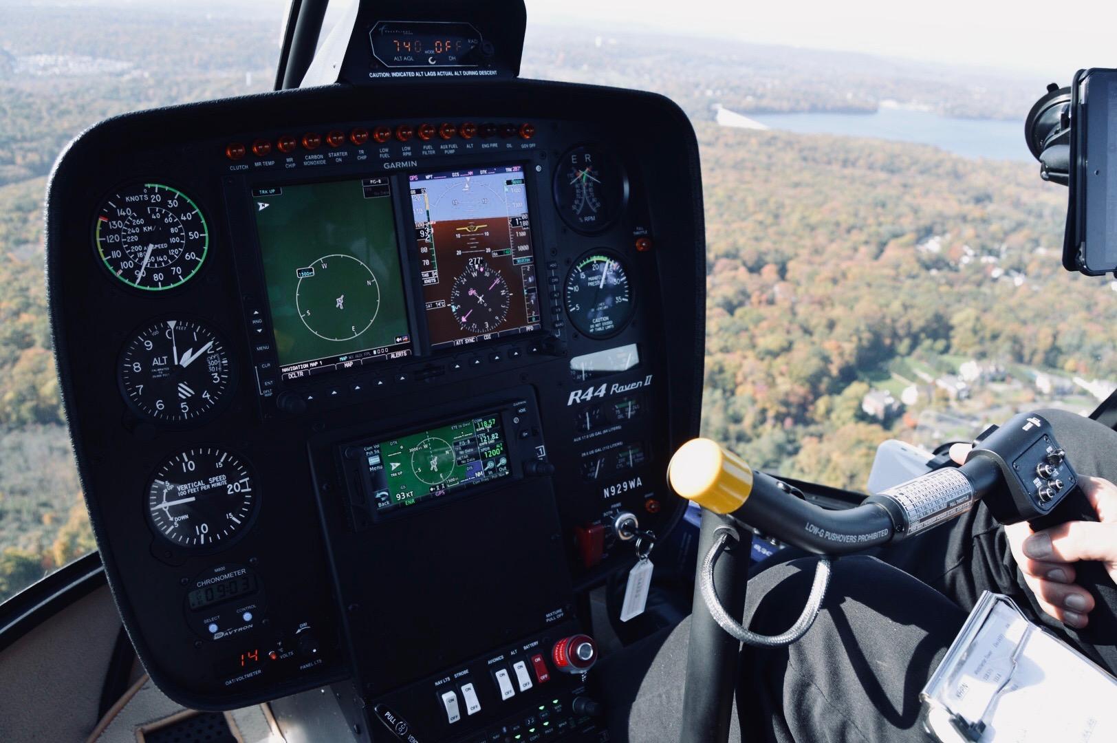 Inside of R44 Raven II Helicopter in flight training