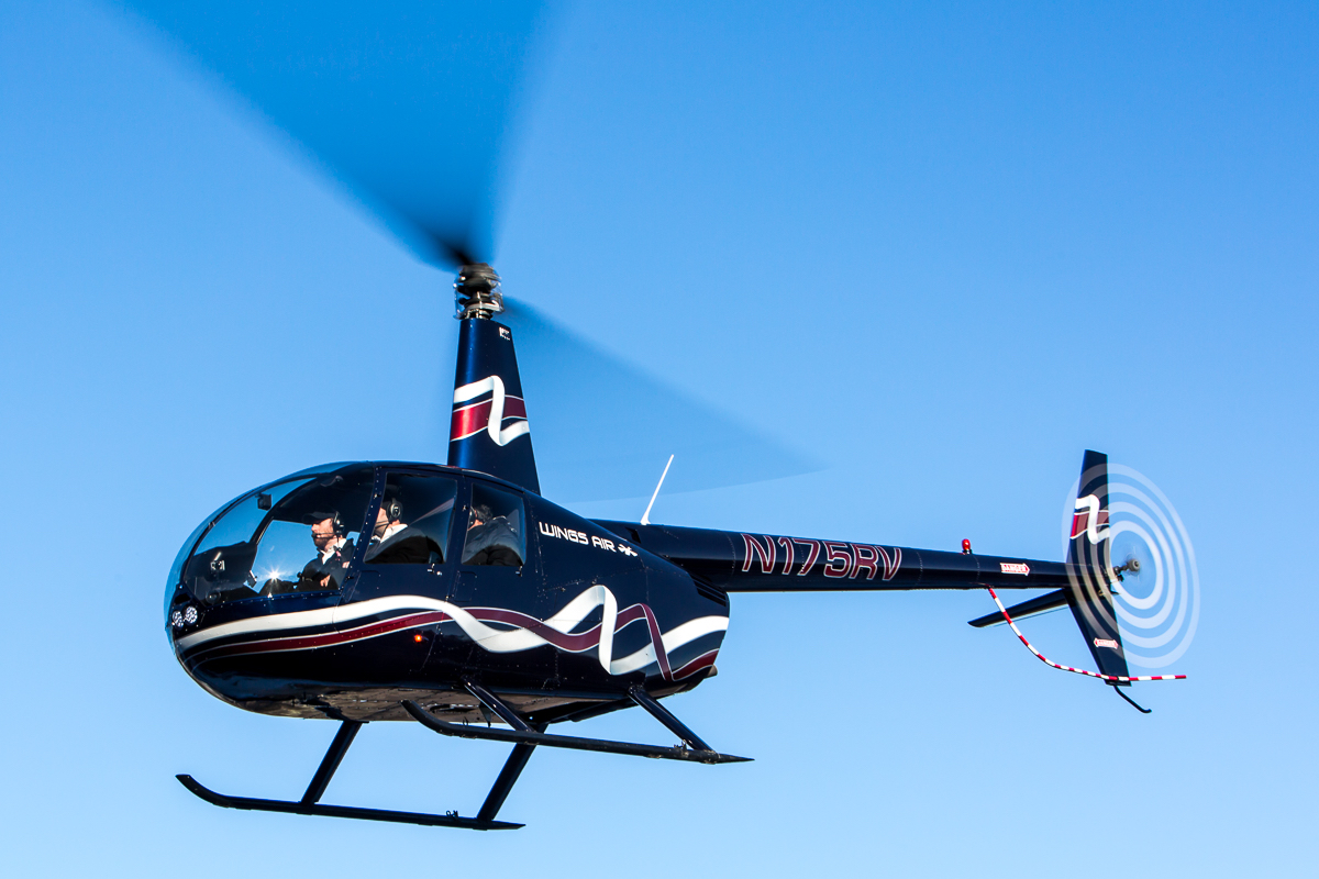R44 Helicopter in air during the day