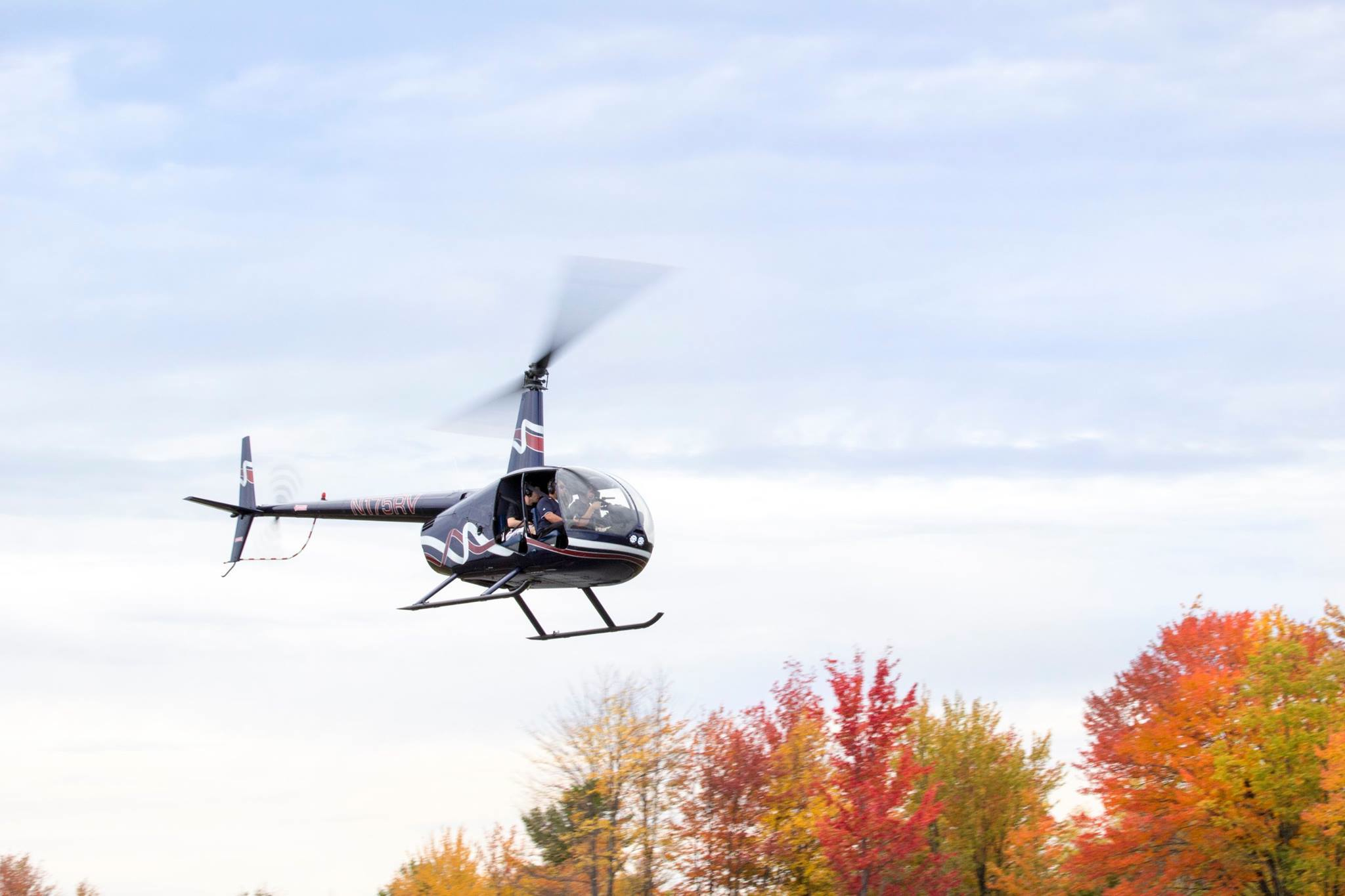 helicopter flying over fall foliage environment