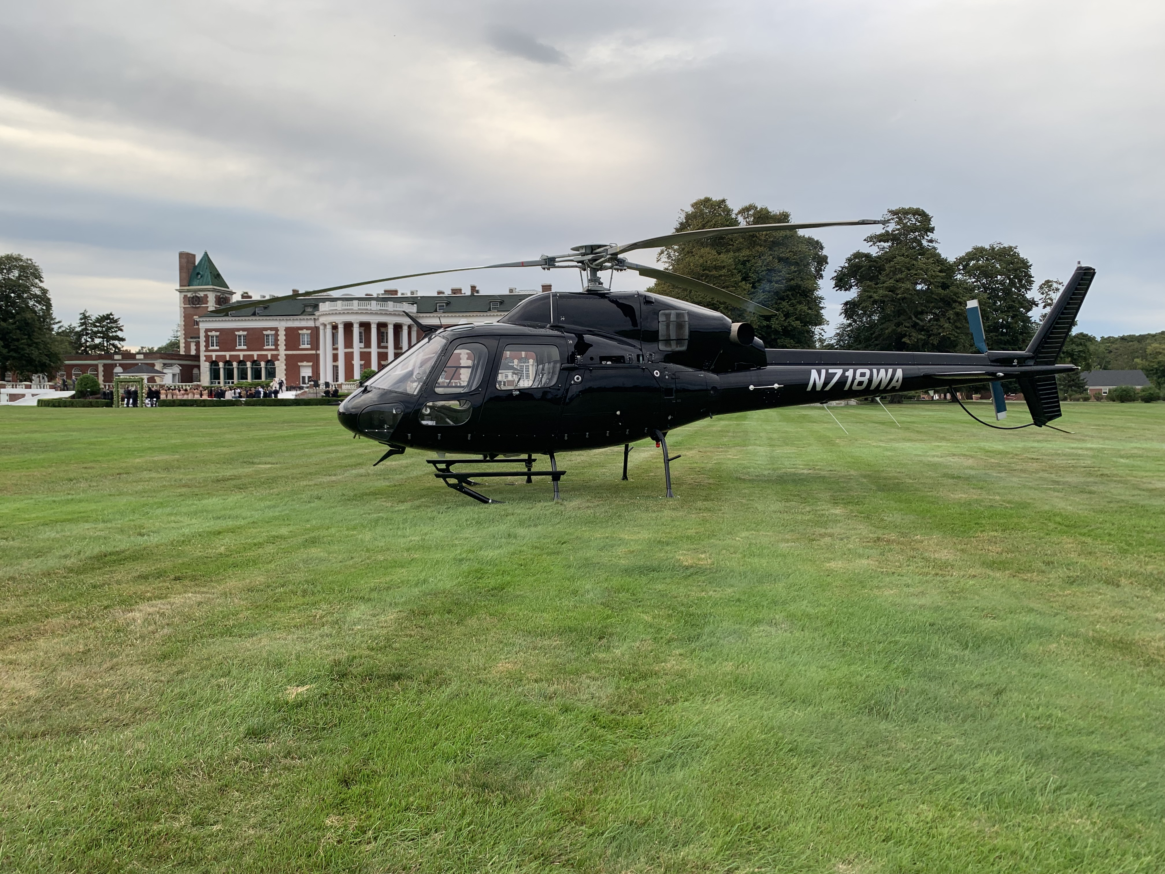 black helicopter in front of bourne mansion