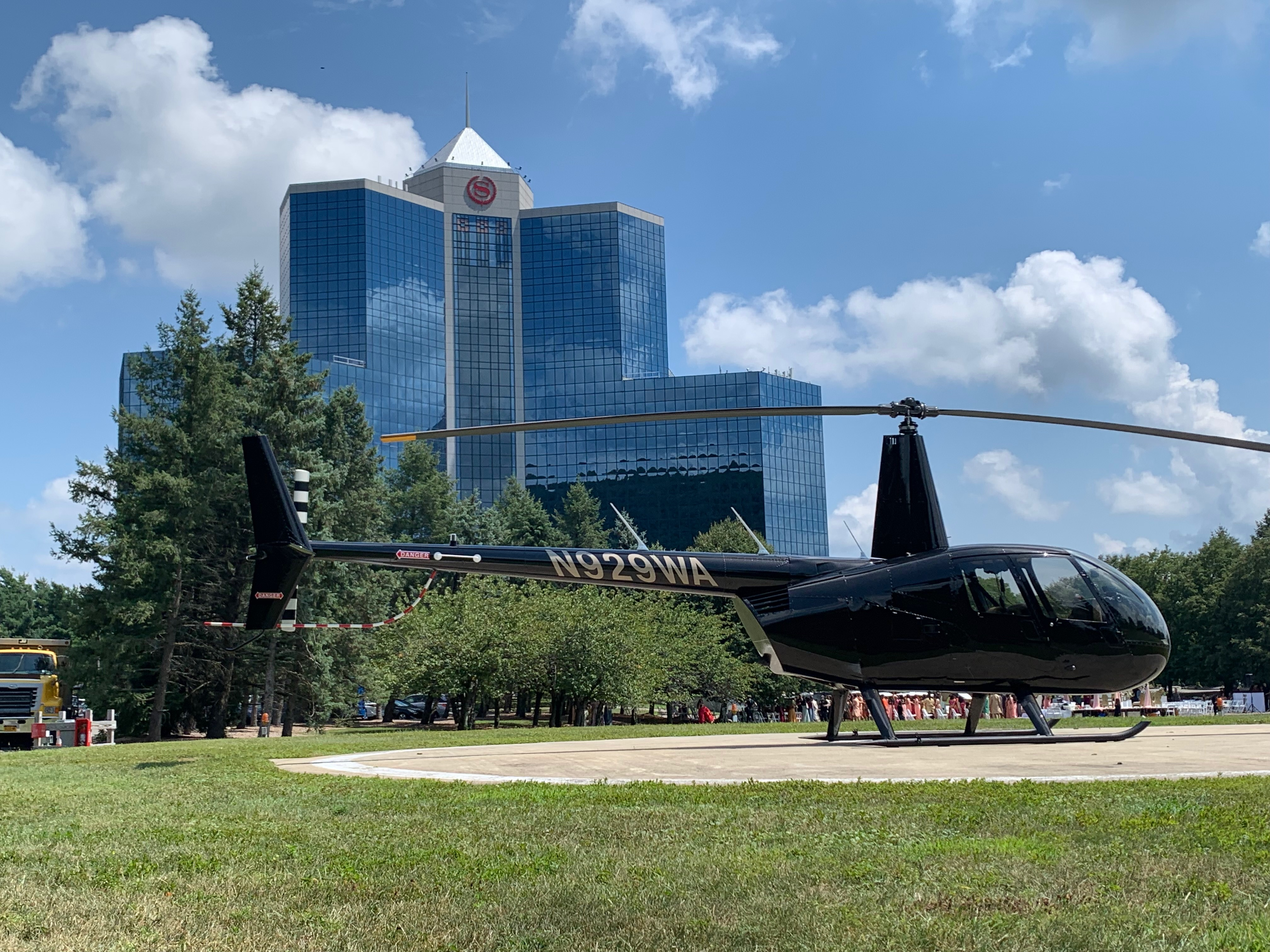 black r44 helicopter in front of the sheraton mahwah hotel