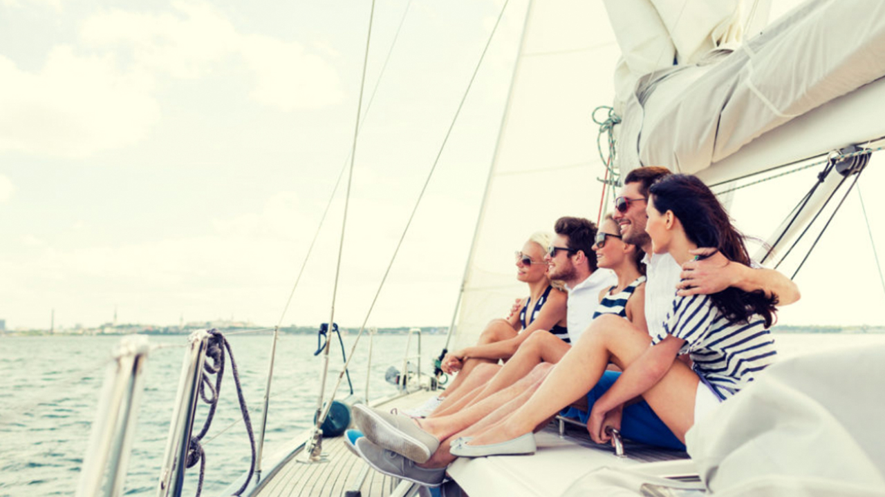 group of people on a sailboat sailing in the ocean