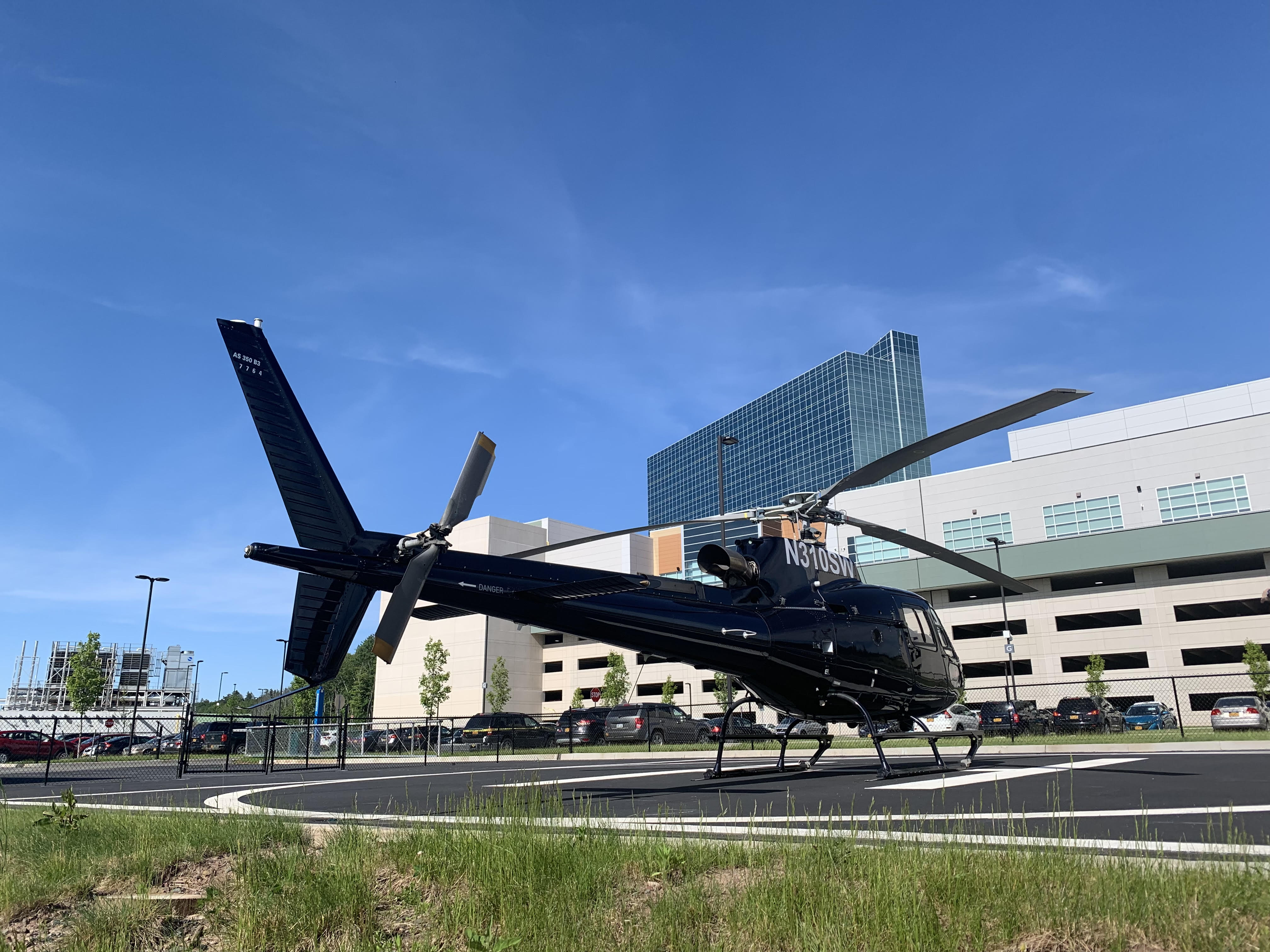 Astar Black helicopter getting ready for takeoff