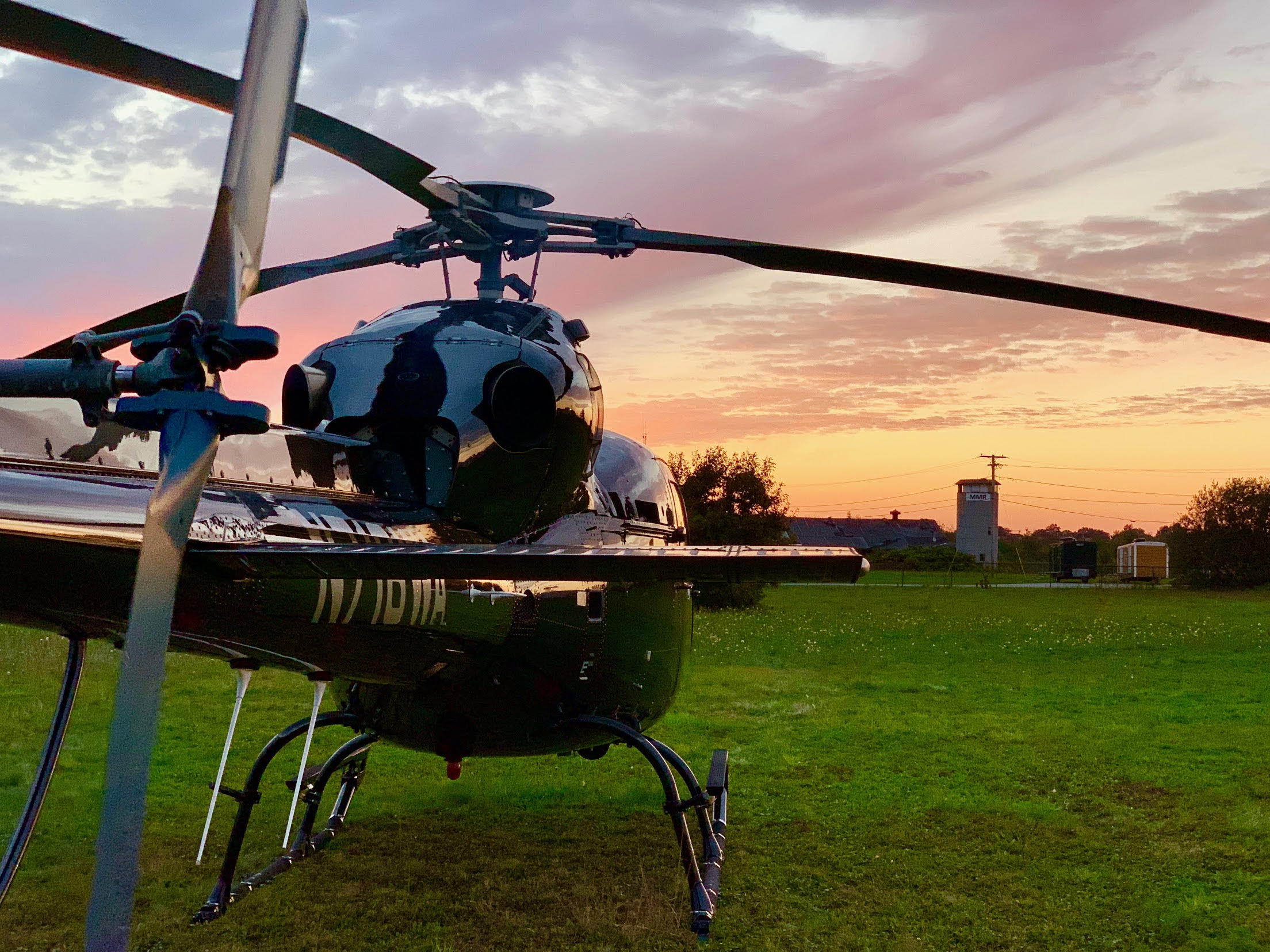 Twin Star Helicopter on the ground during sunset