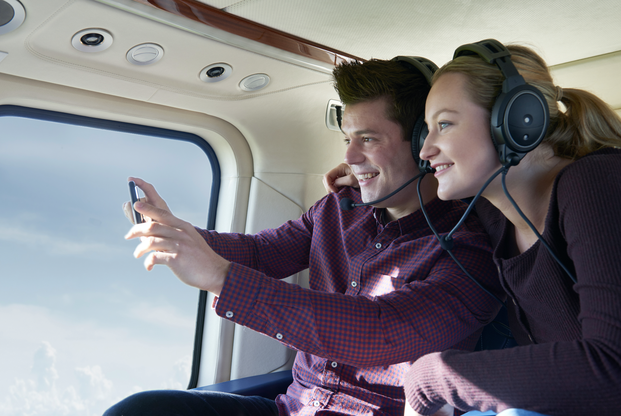 Couple taking pictures in helicopter